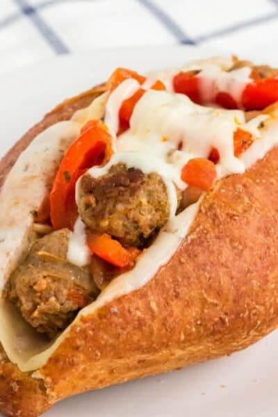 sub roll filled with Instant Pot sausage and peppers