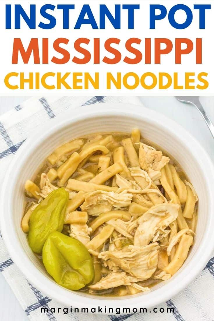 white bowl filled with Instant Pot Mississippi chicken and noodles, resting on a blue and white cloth