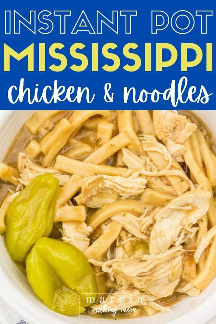 A bowl of Mississippi chicken and noodles cooked in the Instant Pot, with two pepperoncini garnishes,