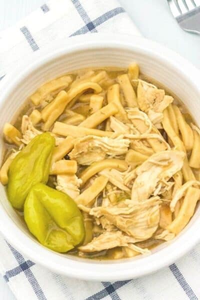 white bowl filled with Instant Pot chicken and noodles