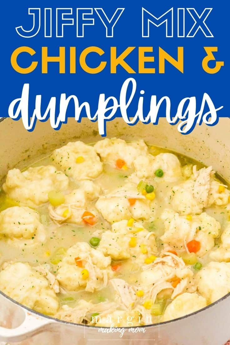 A cream-colored Dutch oven containing a full batch of chicken and dumplings made with Jiffy baking mix