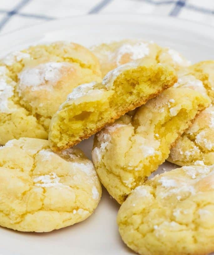 several lemon pudding crinkle cookies on a white plate
