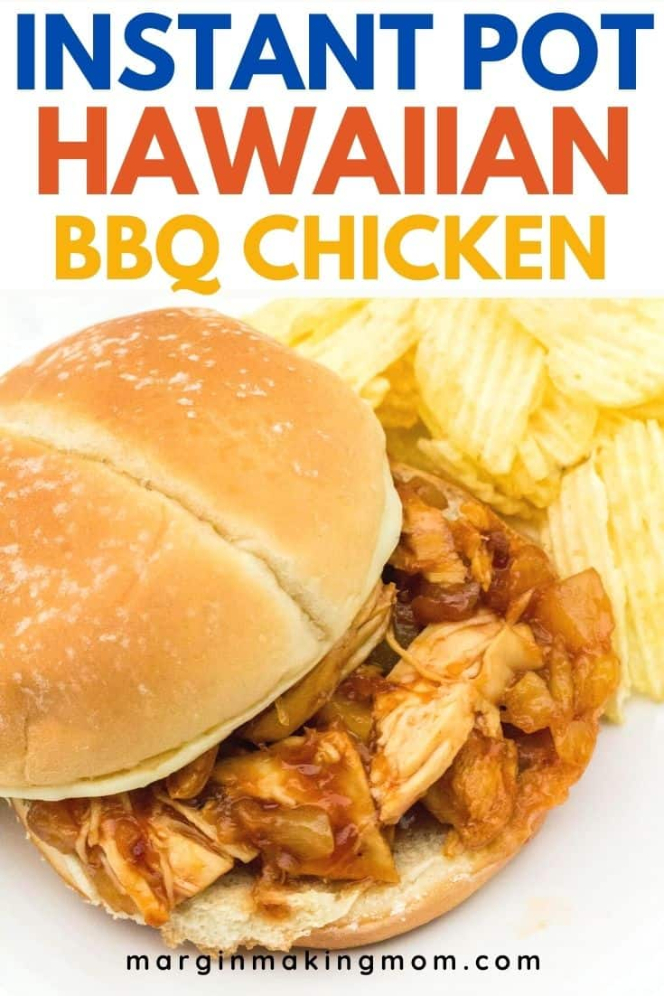 Instant Pot Hawaiian BBQ pulled chicken on a sandwich bun, with potato chips next to it on the plate.