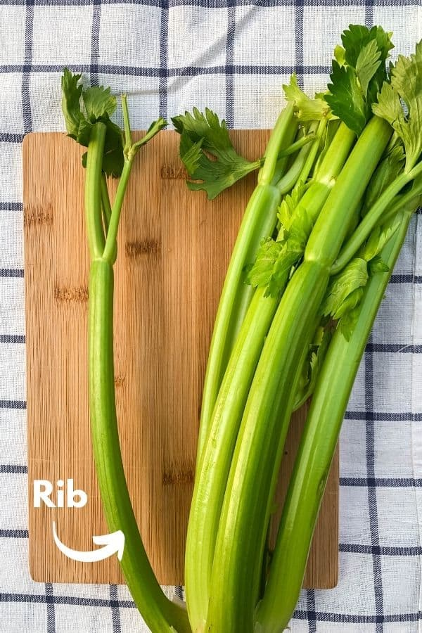 one stalk of celery, with a single rib separated from the bunch, with a label pointing to the individual rib of celery.