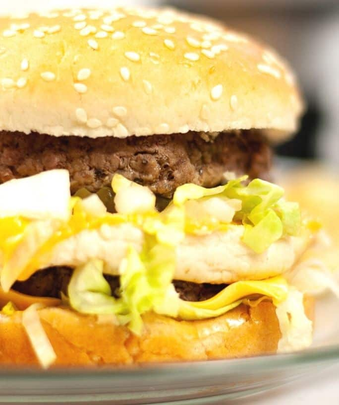 close-up view of an Instant Pot hamburger served on a bun with toppings.