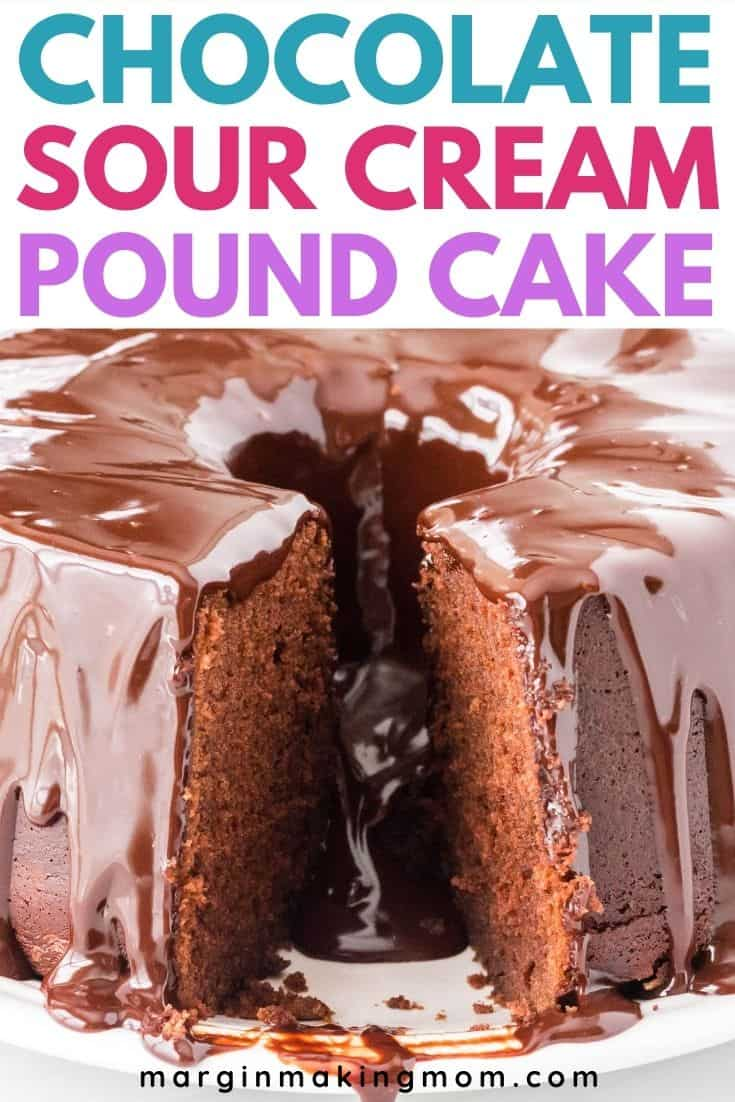 a chocolate sour cream pound cake on a white plate, with a slice cut out of the cake, revealing the moist interior