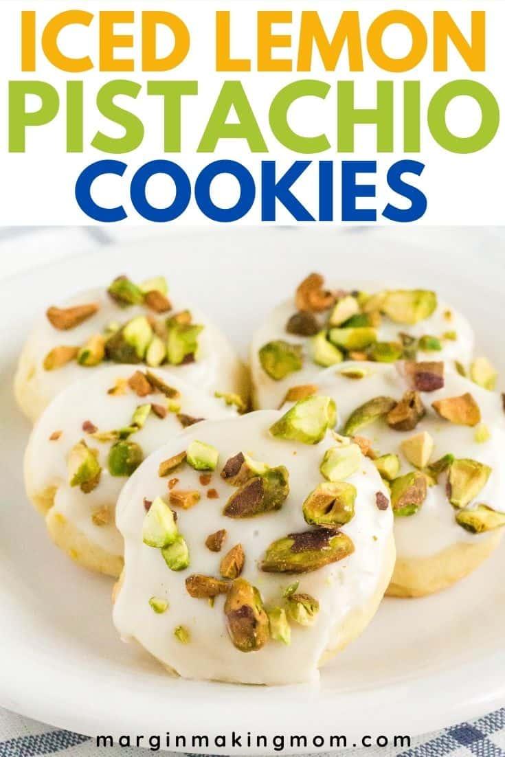 Five lemon pistachio cookies arranged on a white plate