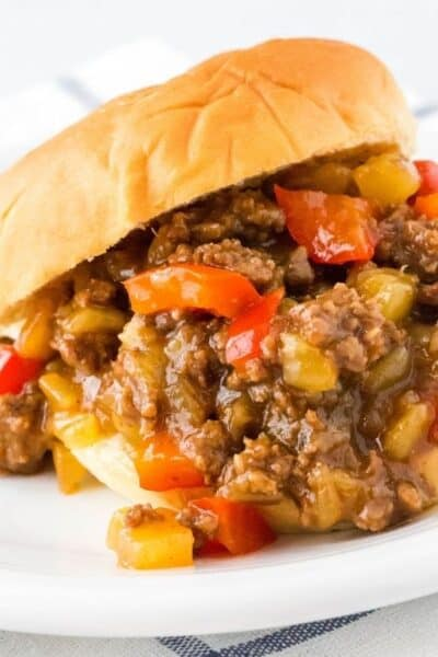 Instant Pot Hawaiian sloppy joes filling spilling out of a bun
