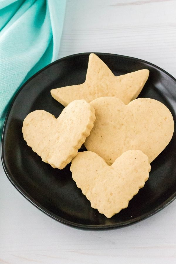 Italian sour cream cutout cookies on a black plate