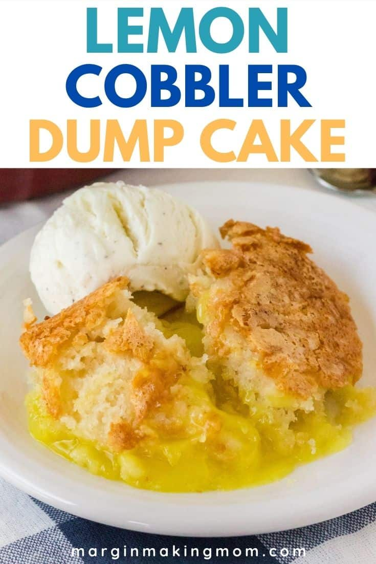 magical lemon cobbler on a white plate with a scoop of vanilla ice cream.