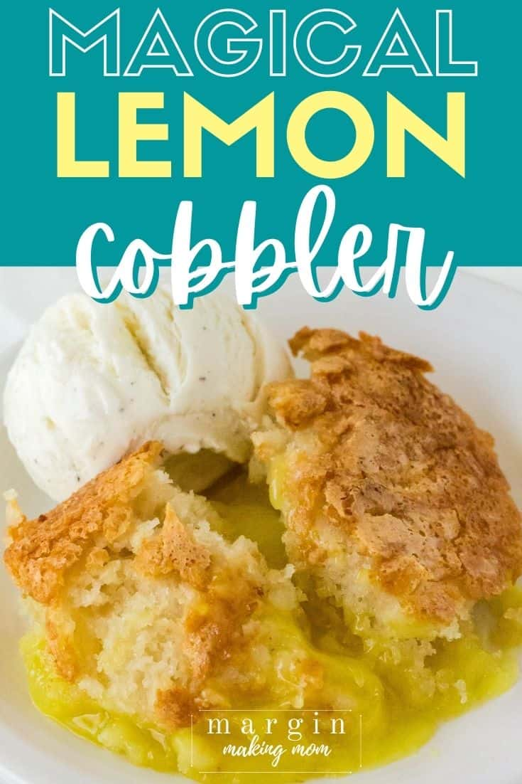 homemade lemon cobbler on a white plate with a scoop of vanilla ice cream.