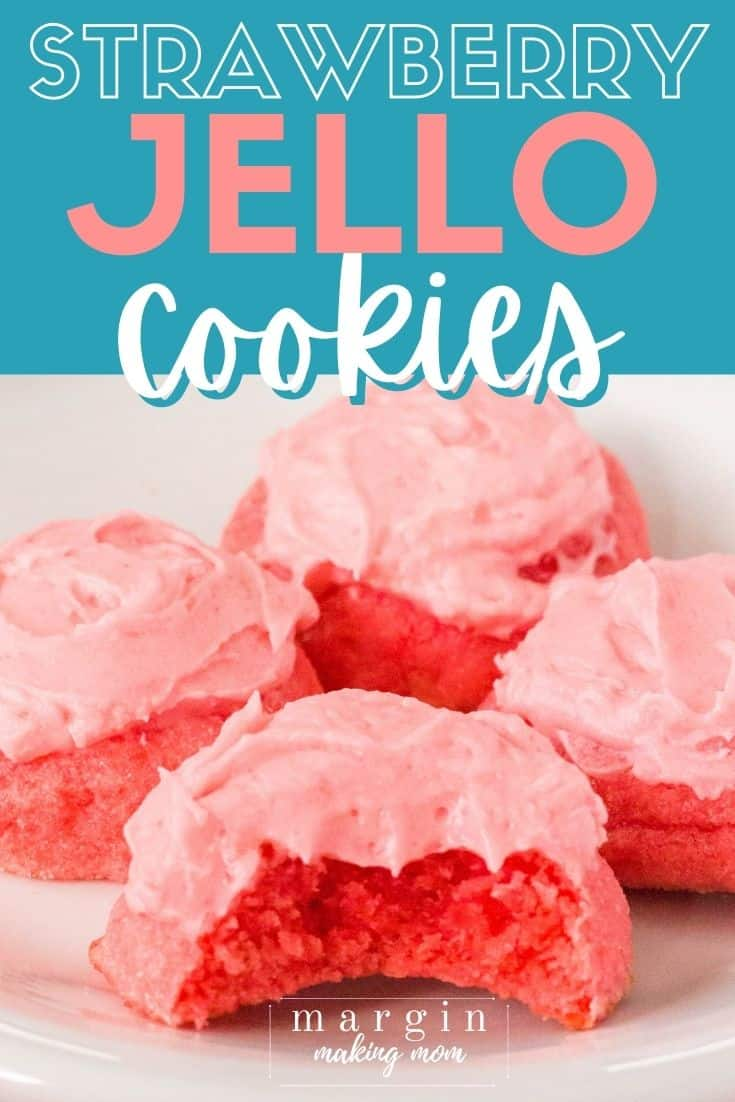 white plate with four frosted strawberry Jello sugar cookies on it.