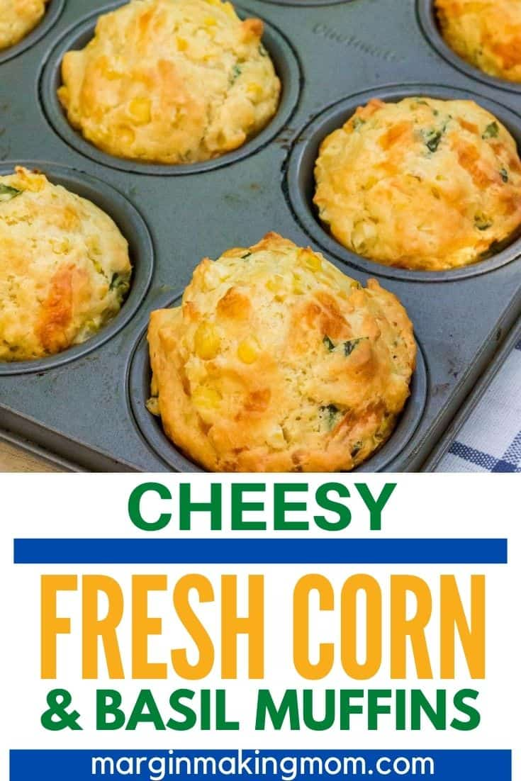 muffin pan with freshly baked muffins filled with fresh corn, basil, and cheese