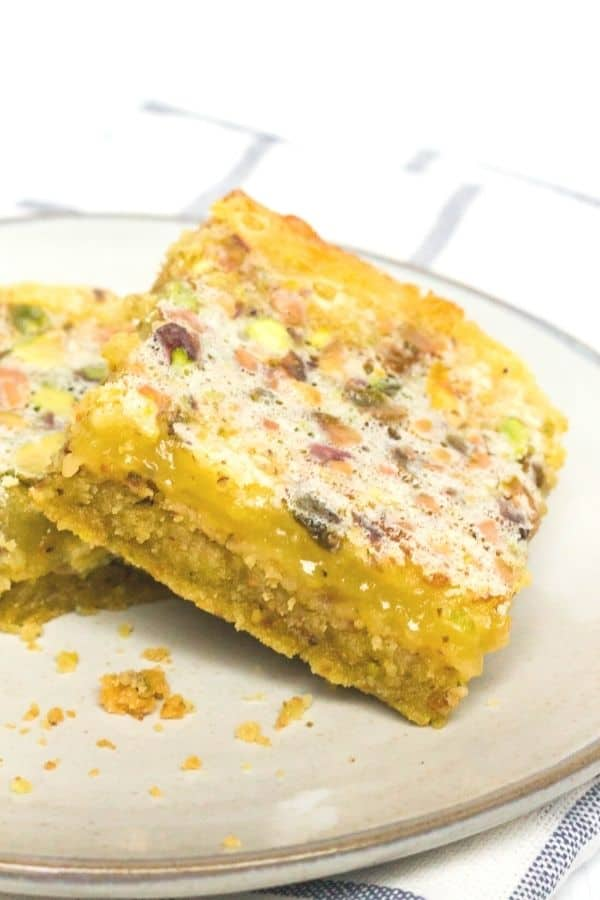 side view of a lemon bar with pistachios in it