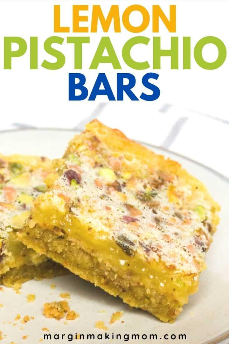 a cream-colored plate serves two lemon pistachio bars