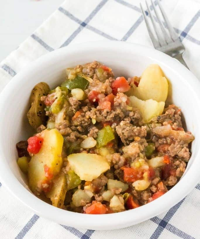 white bowl of Dolly Parton's 5 layer dinner casserole
