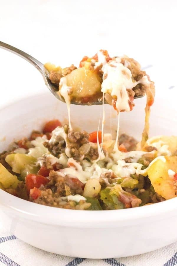 Instant Pot ground beef and potatoes casserole topped with cheese