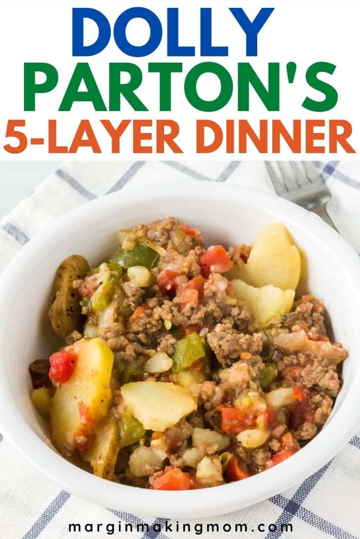 white bowl filled with Dolly Parton's casserole of beef, potatoes, peppers, and tomatoes.