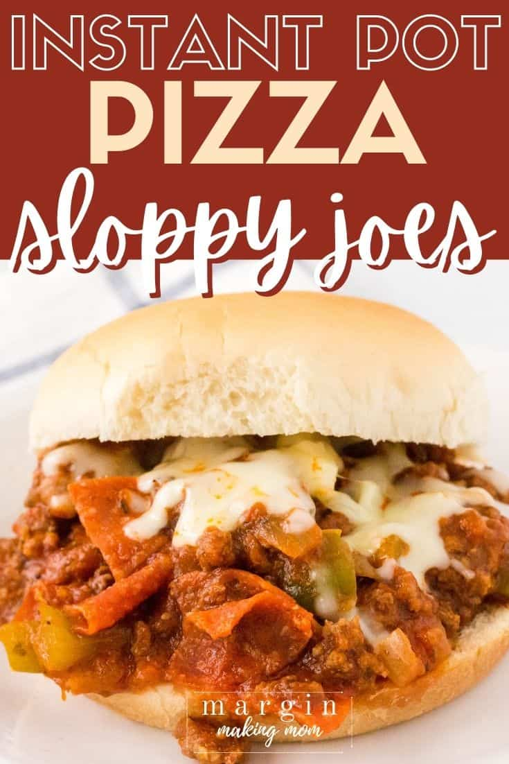 close-up view of an Instant Pot pizza sloppy joe sandwich, with pepperoni, ground beef, bell peppers, and mozzarella cheese.