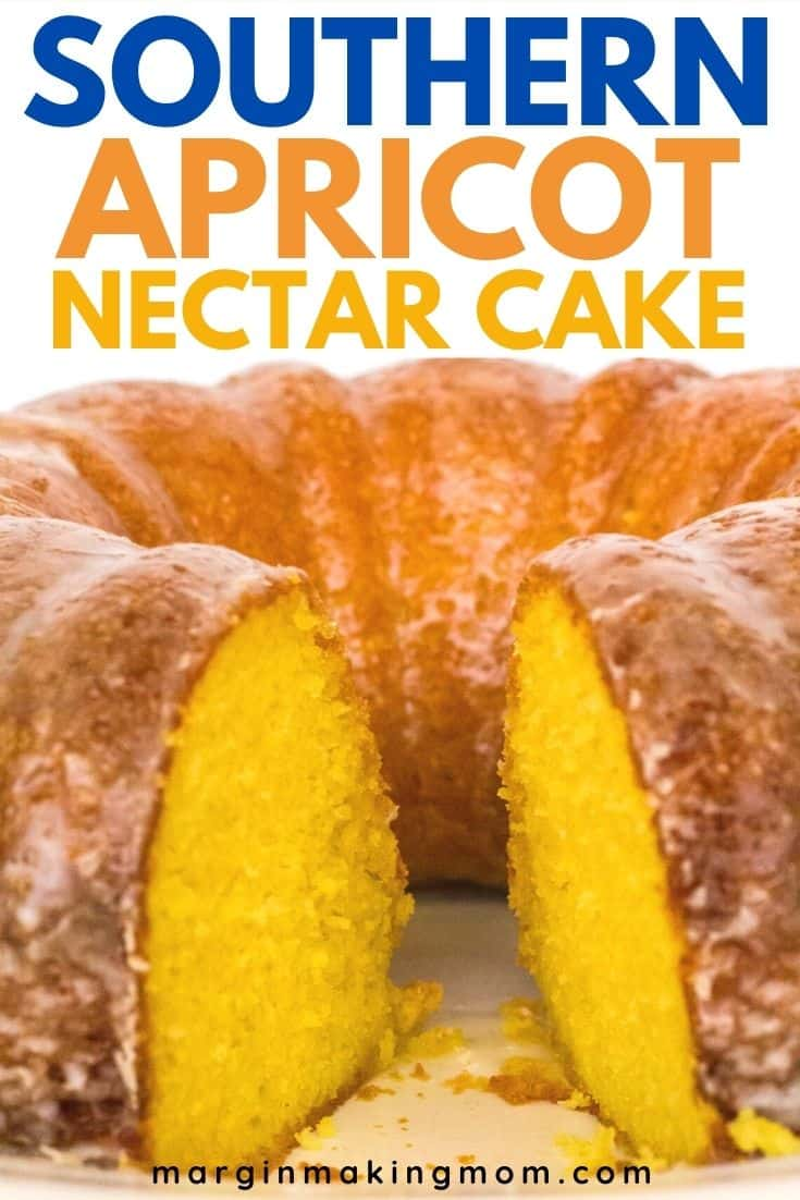 an apricot nectar bundt cake on a white plate, with a slice removed from the cake displaying the moist interior