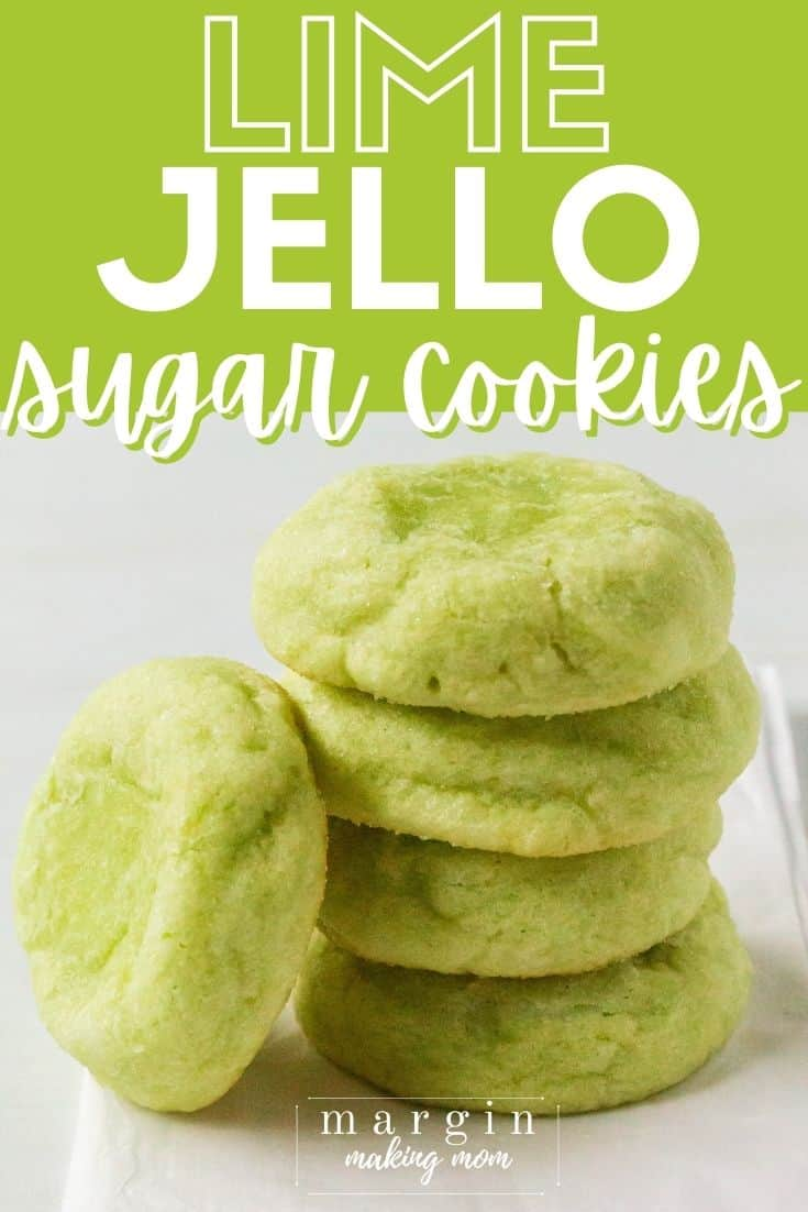 a stack of lime jello sugar cookies on a piece of parchment paper
