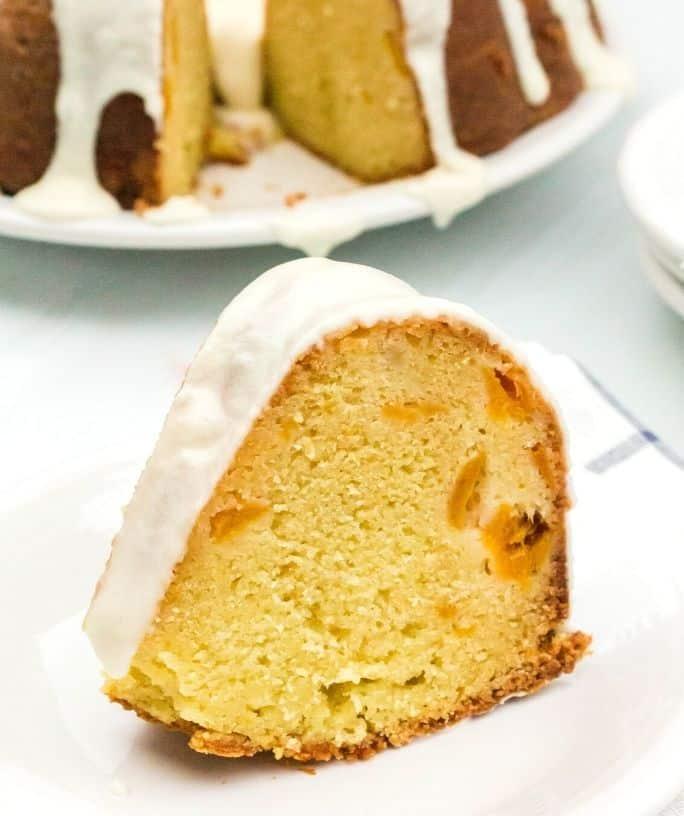 slice of peach sour cream pound cake on a white plate