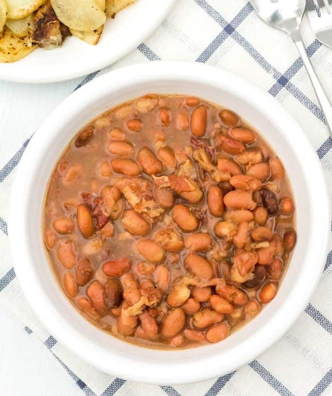 white bowl filled with Instant Pot pinto beans