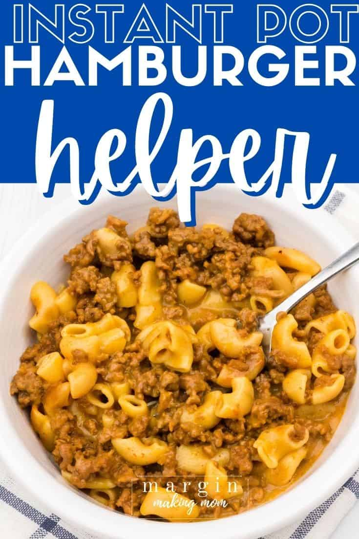 close-up overhead view of a white bowl filled with Hamburger Helper cooked in the Instant Pot, with a fork in the bowl.