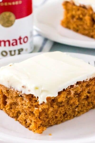 slice of tomato soup cake in front of a can of tomato soup