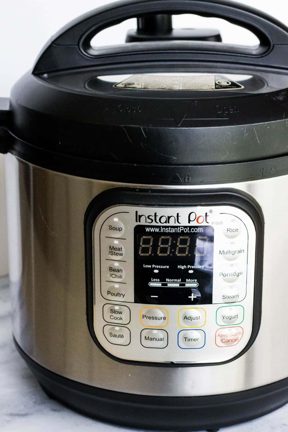 an Instant Pot DUO 60 on a marble kitchen surface