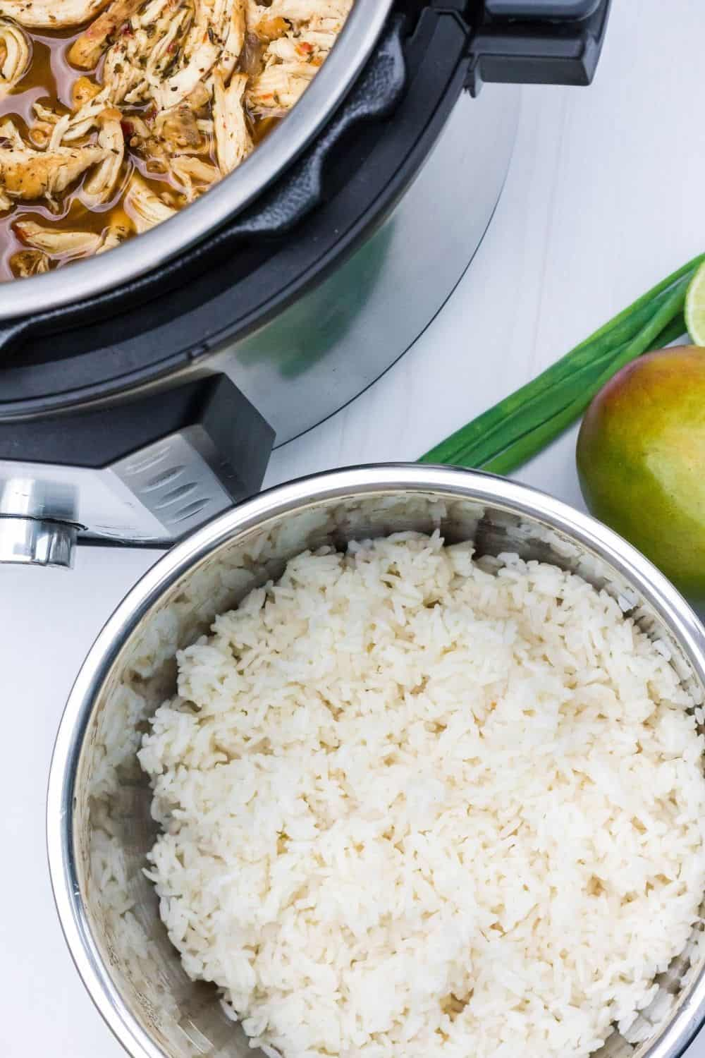 a small insert pot of white rice below the Instant Pot of pulled jerk chicken