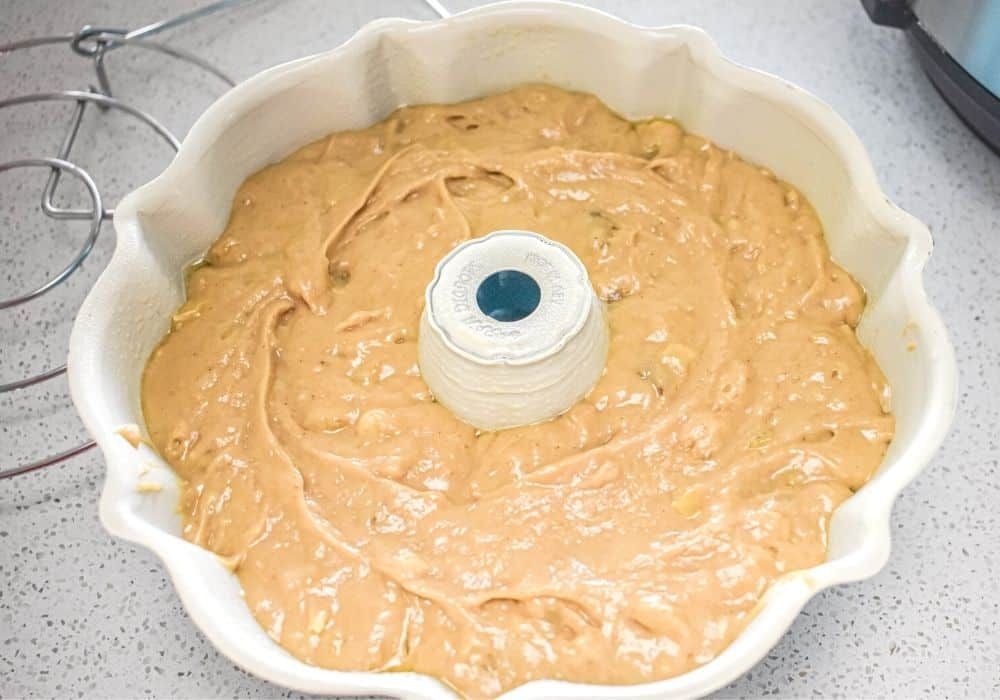 banana bread batter in a bundt pan, ready to be cooked in the Instant Pot