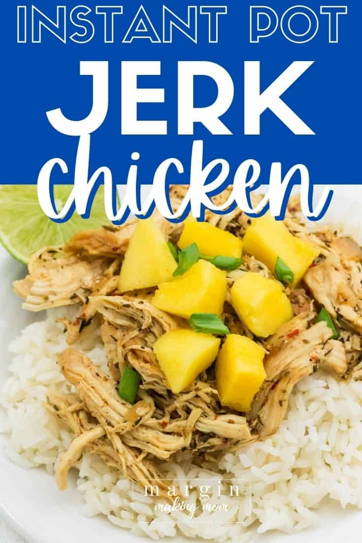 white rice topped with Instant Pot jerk chicken, diced mangos, and sliced green onions, with a lime wedge in the background.