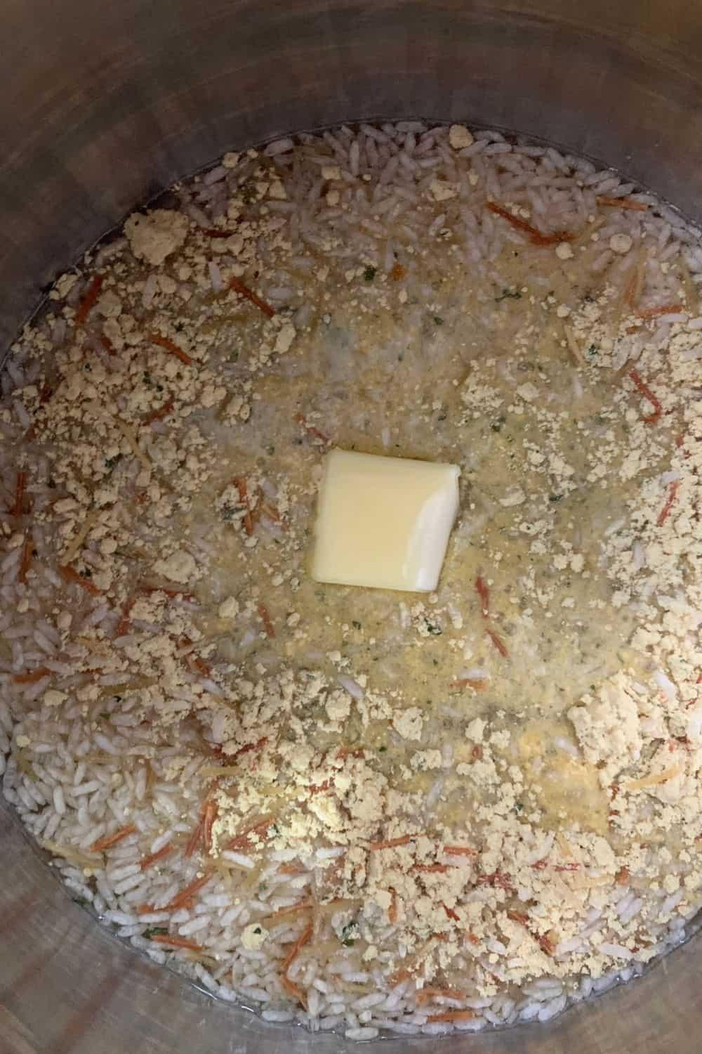 Knorr Rice Sides in the Instant Pot with water and butter, ready to be pressure cooked