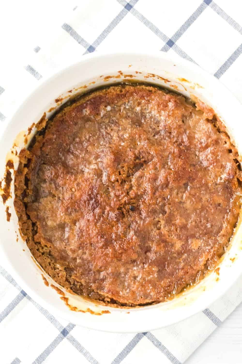 Instant Pot apple dump cake in a white baking dish, after having the top crisped up