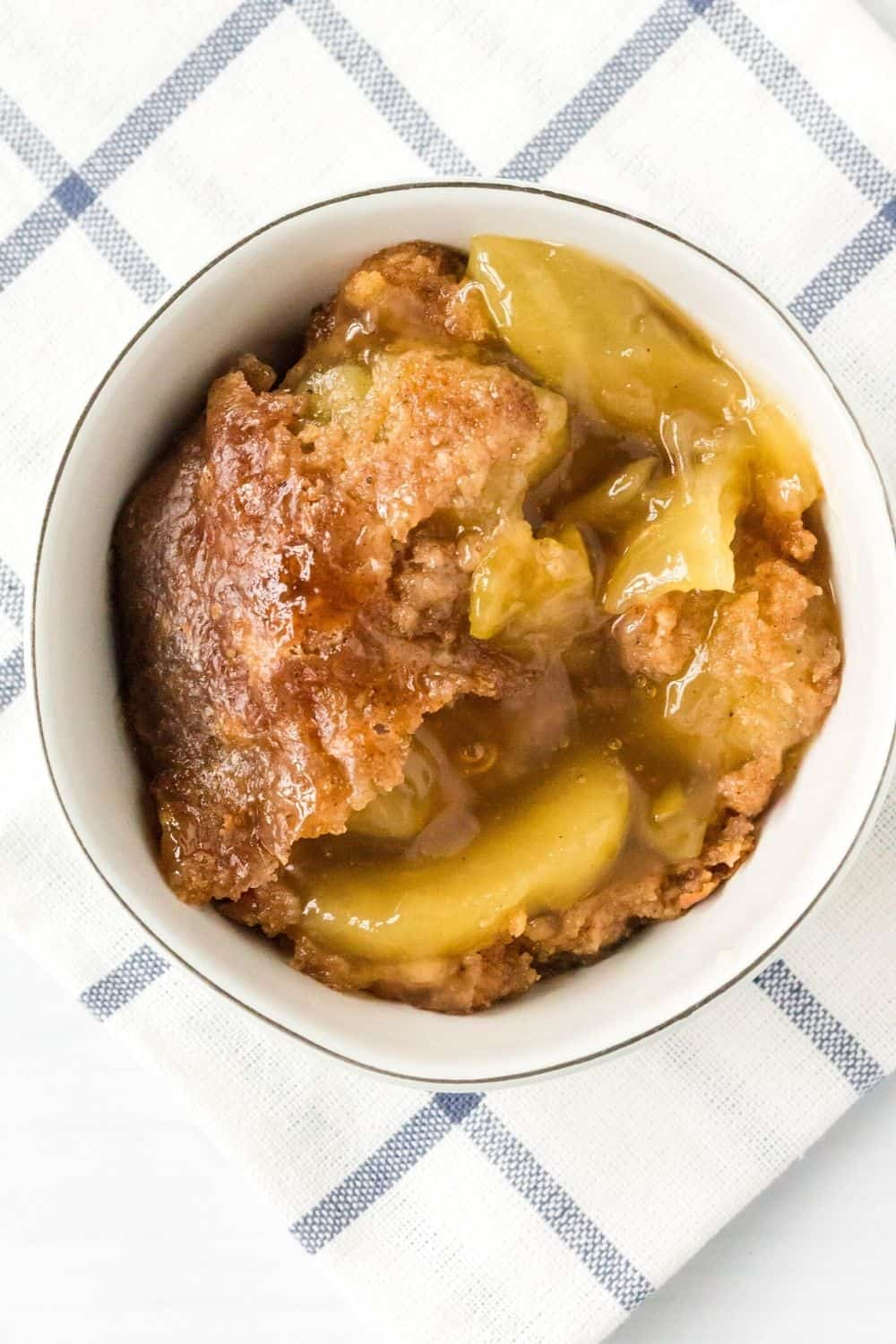 overhead view of a scoop of pressure cooker apple dump cake