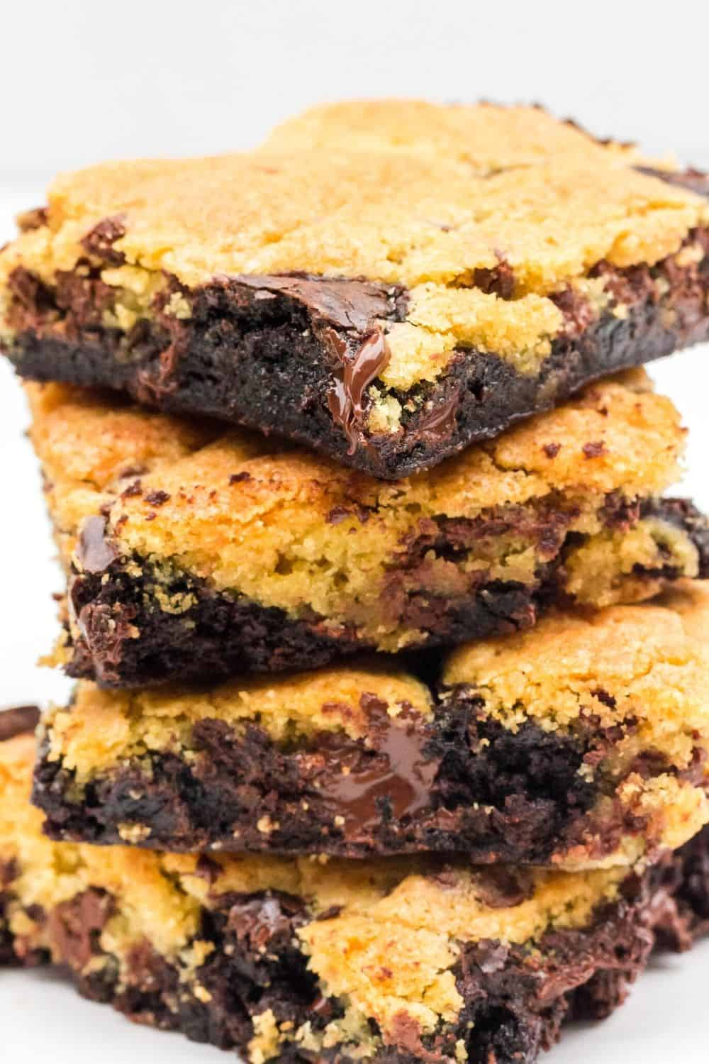 stack of copycat domino's brownie cookie bars on a white plate