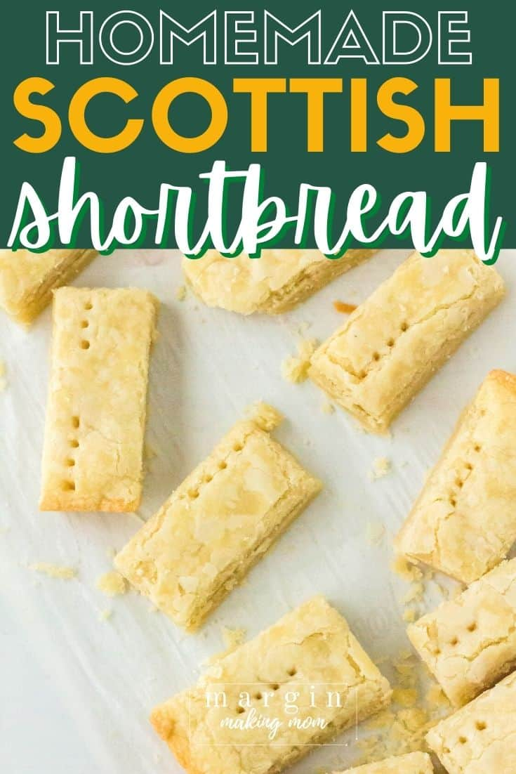 several Scottish shortbread cookies scattered on a piece of parchment paper