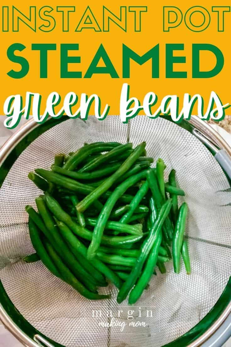 cooked green beans in a steamer basket